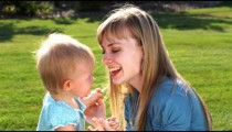 Young couple with their little girl in a garden in slow motion.
