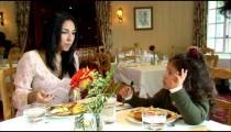 Family having dinner together at a restaurant.
