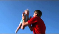 Slow motion shot of a young couple playing with their baby girl in a garden.