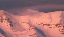 Pan of snowy mountain summit.
