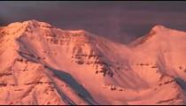 Snowy mountain summit panorama.