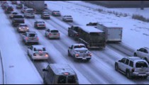 Shot of vehicles driving in a winter storm.