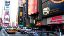 Signs and traffic at Times Square NYC.