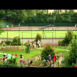 People playing miniature golf and tennis.