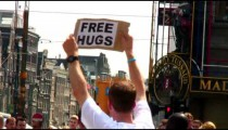 Free Hugs sign in Dam Square Amsterdam.