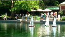 Toy sailboats on a pond in Central Park New York City.