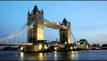Time-lapse of a bridge over Thames River in London.