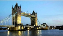 Time-lapse of bridge over River Thames at night in London.