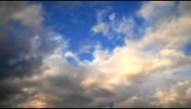 Time-lapse of clouds and blue sky.
