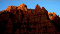 Time-lapse of red rock cliffs at sunset.