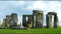 Tilting time-lapse of Stonehenge with white clouds.