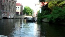 Time-lapse of a boat going down a canal in Bruges Belgium.
