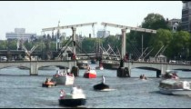 Time-lapse of boats going under bridges in Amsterdam.
