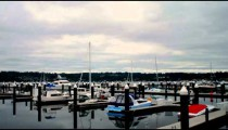 Time-lapse of a boat harbor on a stormy day.