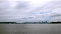 Time-lapse of a distant city skyline.