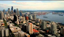 Time-lapse of a city skyline and harbor.