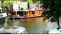 Ferry coming into view on a canal in Amsterdam.