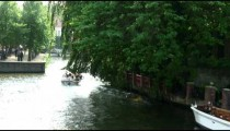 Boat going down a canal in Amsterdam.