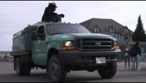 Smokey the Bear waving from a truck.