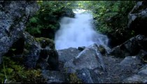 Low angle stationary time lapse of a waterfall in Alaska.