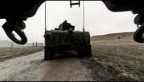 Time-lapse filmed from under a truck at a military training.