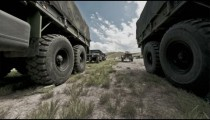 Time-lapse filmed between military convoy trucks.