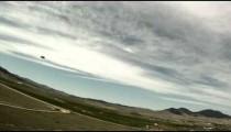 Parachutist landing in an open area