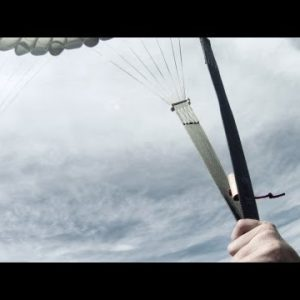 Excited parachutist jumping out of a plane