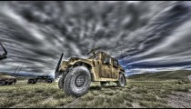 Dollying time-lapse of a stationary Humvee.