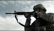Soldier practicing firing assault rifle