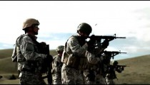 Several soldiers practicing firing assault rifles