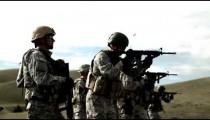 Several soldiers practicing firing assault rifles