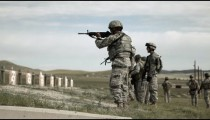 Green Beret soldiers practicing firing weapons at range