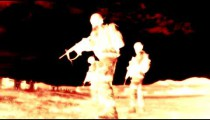 Negative shot of soldiers practicing firing at range