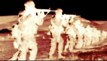 Negative shot of soldiers during firing drill