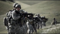 Panning shot of soldiers during shooting drill