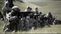 Soldiers firing guns in kneeling stance