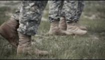 Soldiers' boots walking across the field