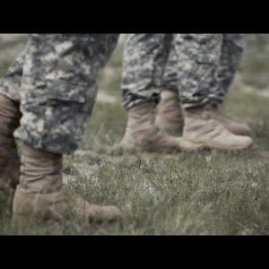 Soldiers' boots walking across the field