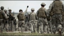 Soldiers walk across training field