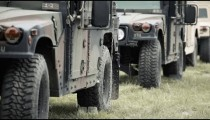 Shot rolls through a line of Humvee's