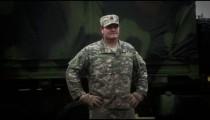 Captain standing in front of convoy truck