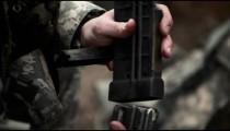 Soldier loading an assault rifle magazine
