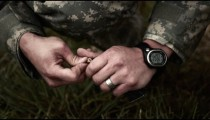Married soldier loads a pistol magazine