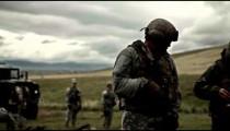 Soldier loads gear into his vest