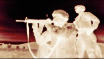Negative shot of kneeling soldier shooting M4 rifle