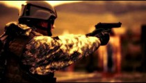 Sepia shot of soldier switching weapons