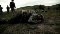 Soldier crawling in field for training
