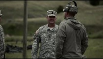 Firing range instructors speaking with one another