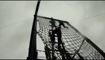 Soldiers climbing down from tower